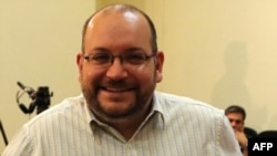 Iranian-American Washington Post correspondent Jason Rezaian poses while covering a press conference at Iran's Foreign Ministry in Tehran in September 2013.