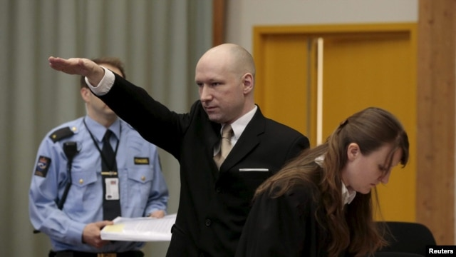 Mass killer Anders Behring Breivik raises his arm in a Nazi salute as he enters the court room in Norway's Skien prison on March 15.