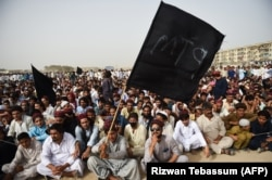 Supporters and activists of the Pashtun Protection Movement (PTM) at a rally in Karachi in May