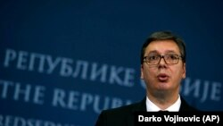 Serbian President Aleksandar Vucic speaks during a press conference after talks with Bosnia's three-member presidency in Belgrade on December 6.