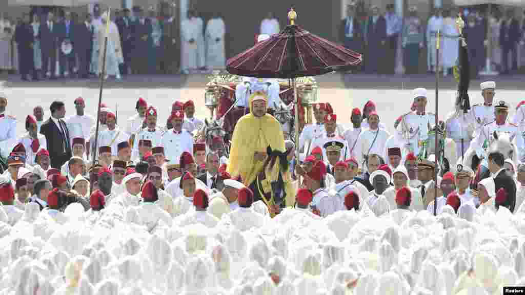 Morocco's King Mohammed VI (center) parades on horseback during celebrations marking the 13th anniversary of his accession to the throne in Rabat on August 21. (REUTERS/Maghreb Arabe)