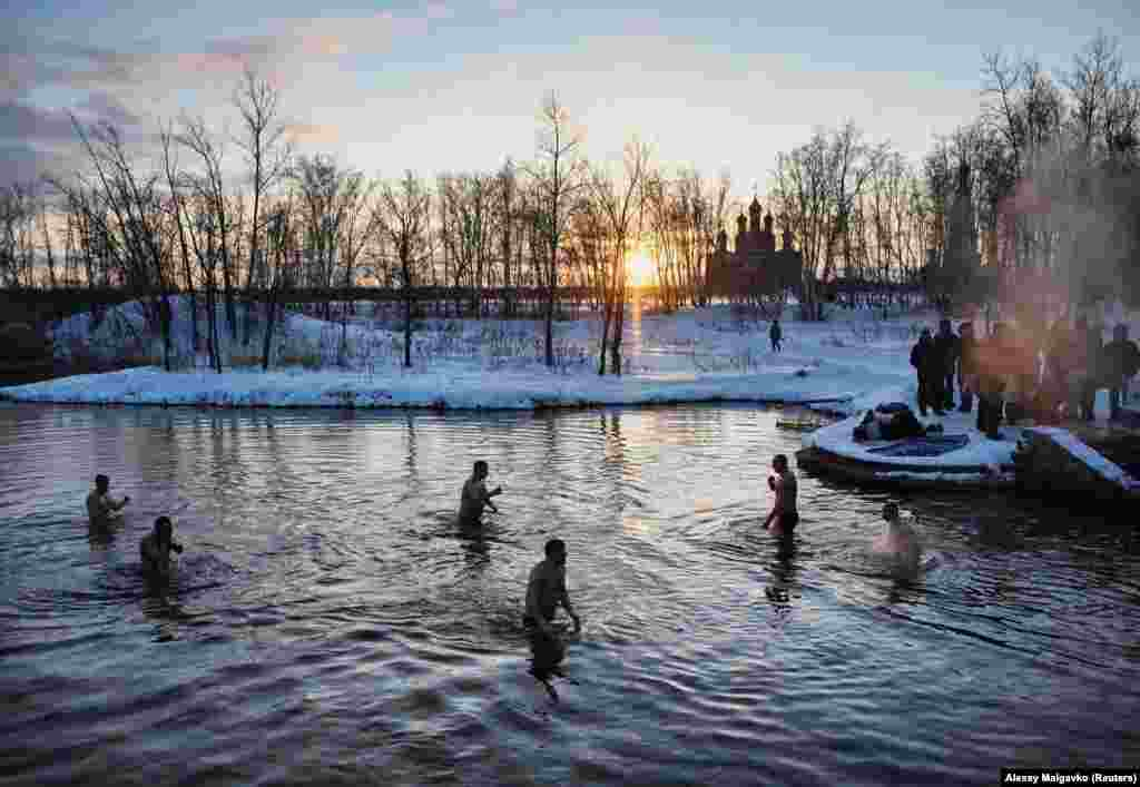 Russia, January 19: Orthodox Christians celebrate Epiphany with an icy swim in Omsk. The following day, two Chinese inside Russia tested positive for COVID-19. There are officially no deaths in Russia attributed to the coronavirus as of March 23.