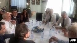 Фото з твітера Могаммада Джавада Заріфа: сам міністр (2-й л), Емманюель Макрон (2-й п), Жан-Ів Ле Дріан (3-й п) під час зустрічі, Біарріц, 25 серпня 2019 року