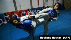 Afghan women take part in a tae kwon do training session at a gym in Herat province. (file photo)