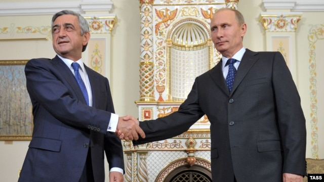 Armenian President Serzh Sarkisian (left) is going along with Russian President Vladimir Putin -- or is he?