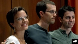 Sarah Shourd, Shane Bauer, and Josh Fattal at a news conference in New York following the men's release from Iranian detention late last week.