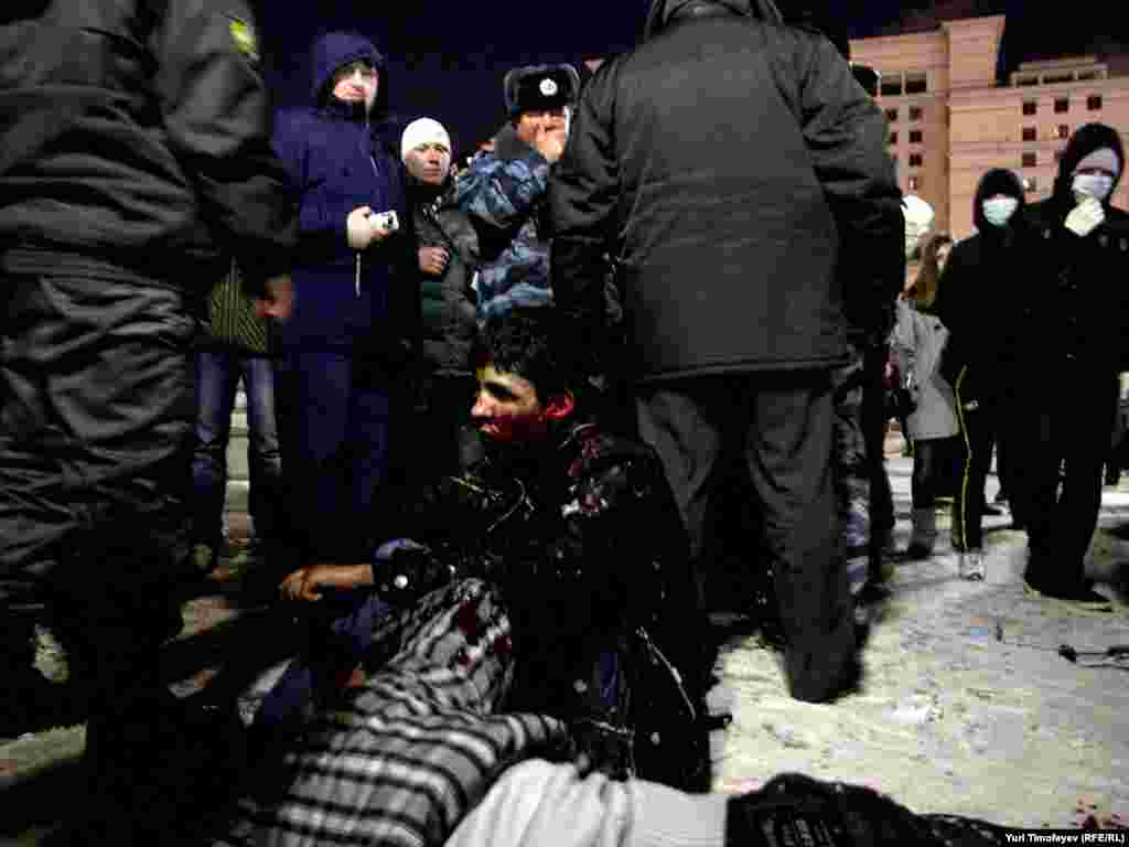 Men who appeared to come from the Caucasus were beaten up by protesting fans.