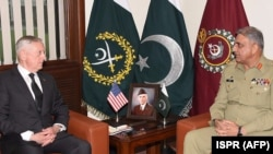FILE: Pakistani Army Chief General Qamar Javed Bajwa (R) speaks with U.S. Defense Secretary Jim Mattis during a meeting in Rawalpindi, Pakistan on December 4, 2017.