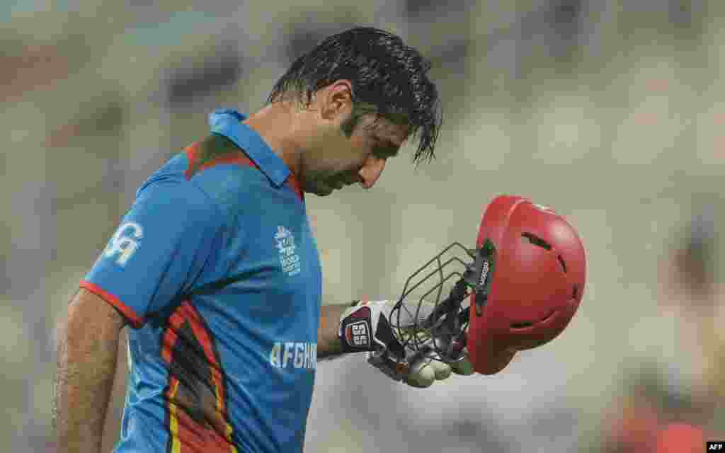 Afghanistan captain Asghar Stanikzai reacts as he walks to the pavilion after his dismissal during the World T20 cricket tournament match between Sri Lanka and Afghanistan on March 17.