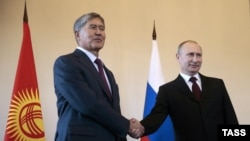 After a long absence from public view, Russian Russian Vladimir Putin (right) resurfaced on March 16 to meet with his Kyrgyz counterpart, Almazbek Atambaev, in St. Petersburg.