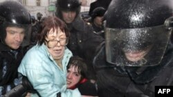 Russian riot police detain opposition activists during a rally in Moscow in March.