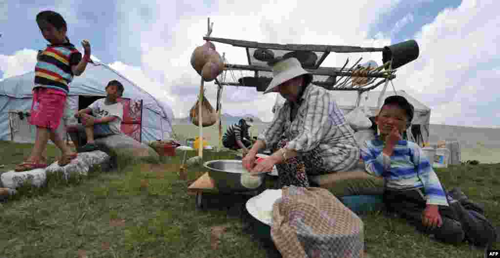 Women cook near a yurt, the traditional portable dwelling on nomads, on Kyrgyzstan's Suu-Samyr plateau, 2,500 meters above sea level, near the ancient Silk Road network of trade routes between the East and West. (AFP/Vyacheslav Oseledko)