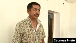 Айдарбек Намазбаев, бывший начальник дорожной полиции города Талдыкоргана, в зале суда. Июль 2015 года.