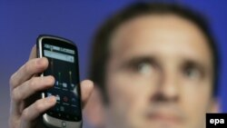 Google's Mario Queiroz holds up the Nexus One smartphone at Google headquarters in Mountain View, California.