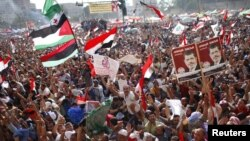 Egypt -- Supporters of Muslim Brotherhood's presidential candidate Muhammad Morsi celebrate his victory in the election on Tahrir Square in Cairo, 24Jun2012