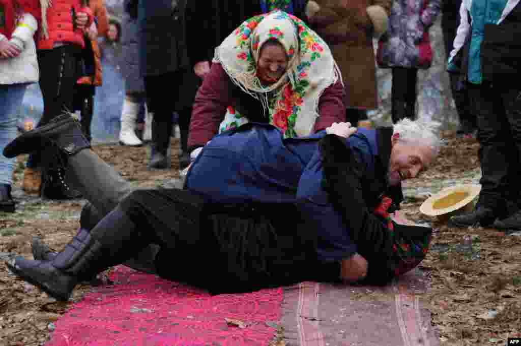 Villagers roll over as they take part in Shrovetide celebrations in the village of Tonezh, some 280 kilometers from Minsk, Belarus. (AFP/Sergei Gapon)