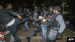 برخورد میان یهودیان اتیوپیتبار و پلیس در تلآویو. ۳ مه ۲۰۱۵
