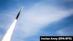 An Iranian air-defense missile is fired during drills in an undisclosed location in Iran.