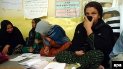Women learn to read and write at at a vocational training institute run by the Afghan Women's Affairs Department in Kunduz.