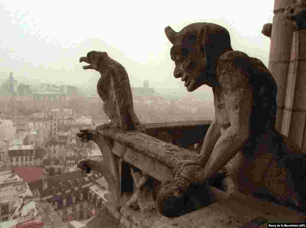 Gargoyles watch over the streets of Paris from the facade of the cathedral in 1996.