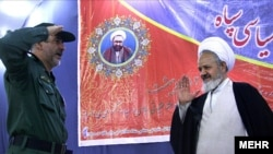 Cleric Ali Saidi (right), Supreme Leader Ayatollah Ali Khamenei's representative to the IRGC