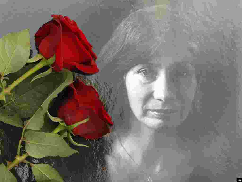 Flowers cover a photo of slain journalist and human rights activist Natalya Estemirova at a protest rally in Moscow on July 16, 2009.