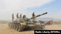 FILE: An Afghan Army tank during a military operation in Kunduz