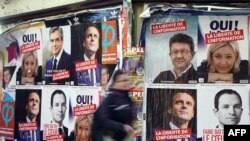 Freedom of information is urged on French presidential campaign posters in Paris.