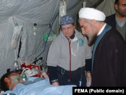 Hassan Rouhani head of Iran's security council at the time visiting a field hospital set up by the U.S. for victims of Bam earthquake in 2003. Photo Undated