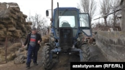 Armenia -- Gor Karapetian, a farmer from Haykavan village, shows his tractor that was stolen on the Turkish border in September, February 11, 2019.