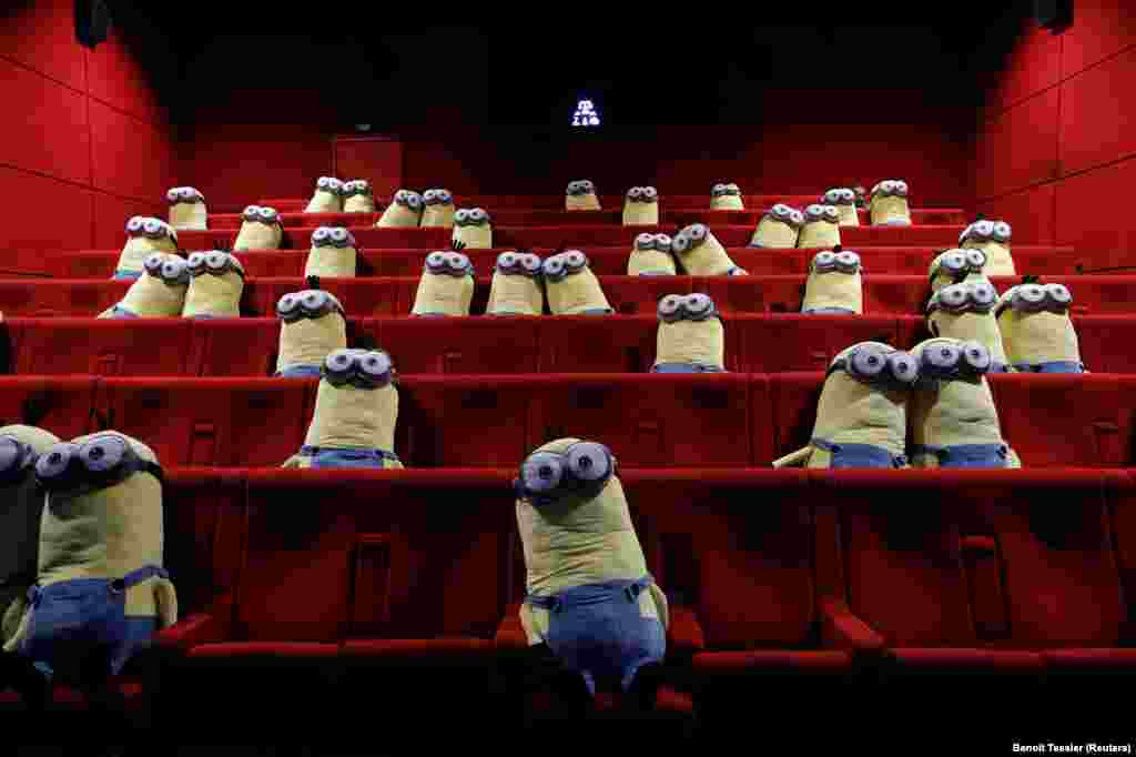 "Stuffed ""minions"" laid out in a movie cinema in Paris to enforce physical distancing on June 22."