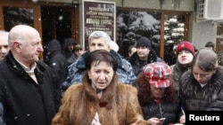 Disqualified presidential candidate Alla Dzhioyeva speaks to the media outside the Central Election Commision building in Tskhinvali on November 30.