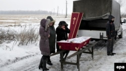 Relatives attend the funeral of 11-year-old Artem Lytkin, who was killed during shelling on Debaltseve on January 19.