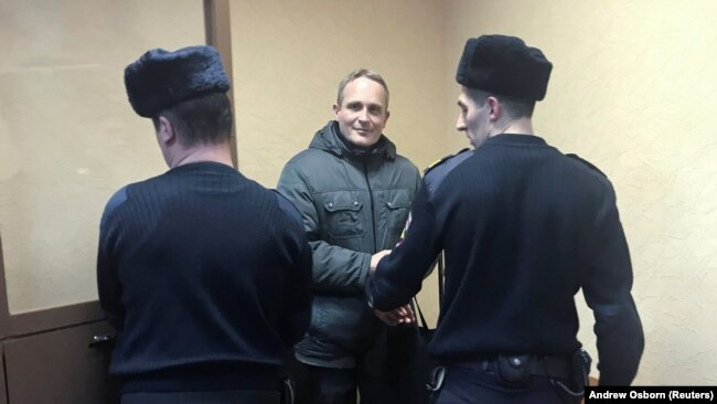 Dennis Christensen (center), a Jehovah's Witness, has been sentenced to six years in Russia on extremism charges.