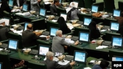 Iran lawmakers vote during a parliamentary session in Tehran in June. (file photo)