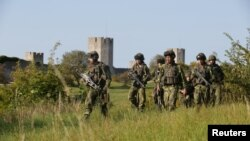 Swedish soldiers patrol outside Visby on the Baltic island of Gotland.