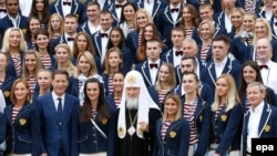 Russian Olympic team members pose for a family photo with Patriarch Kirill (center) at Uspensky Cathedral in Moscow on July 27.