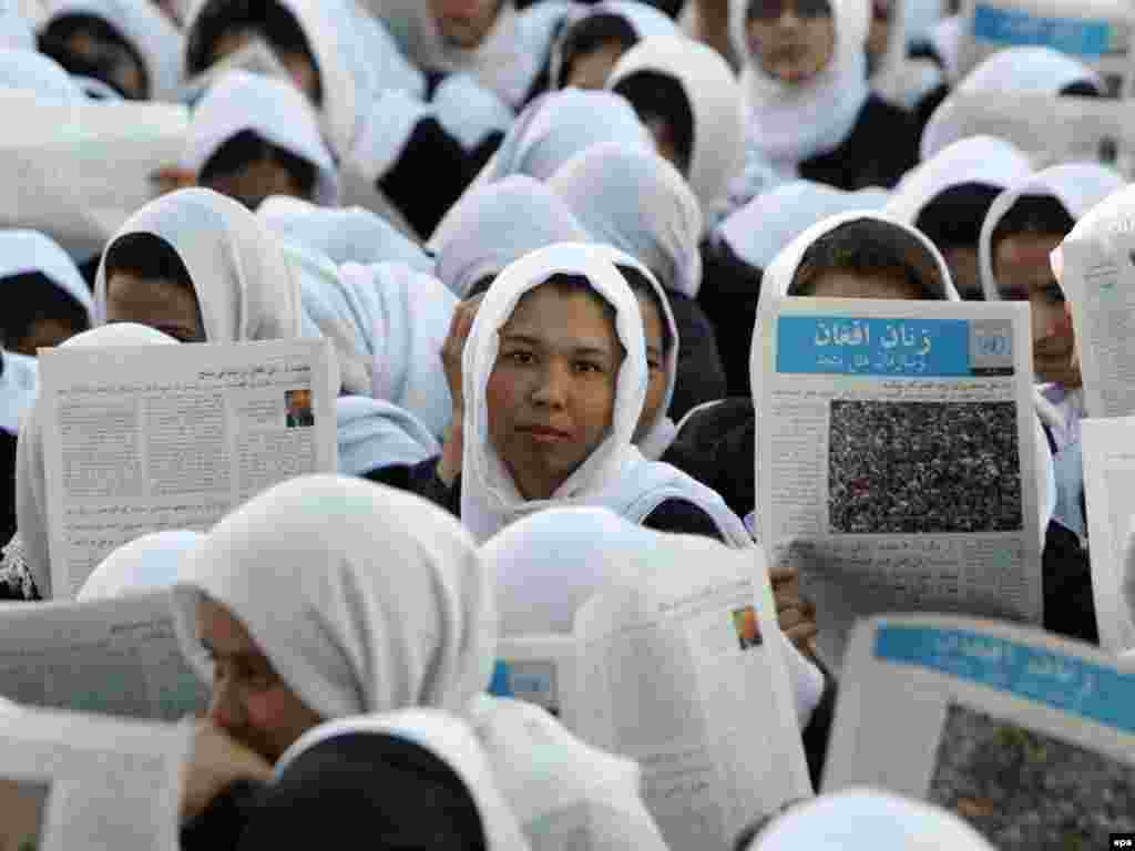 Afghan schoolgirls attend a lecture during a campaign program in Mihri High School in Herat City on September 5. (Photo by Jalil Rezayee for epa)