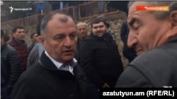Armenia - Gagik Melikian of the ruling Republican Party promises cash to a voter in Tavush province, 18Mar2017.