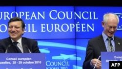 European Commission President Jose Manuel Barroso (left) and European Council President Herman Van Rompuy speak during a press conference after the EU summit in Brussels early today.