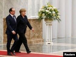Канцлер Німеччини Ангела Меркель та президент Франції Франсуа Олланд на зустрічі у «нормандському форматі». Мінськ, 11 лютого 2015 року in Minsk, February 11, 2015