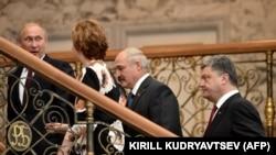 Украинскиот и рускиот претседател Петро Порошенко и Владимир Путин во Минск.