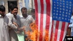 Pakistanis burn a U.S. flag during a protest in Multan on September 10 following the raid in Angor Adda.