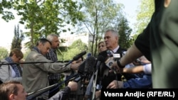 Serbian presidental candidate Tomislav Nikolic talks to reporters after voting in Belgrade on May 20.