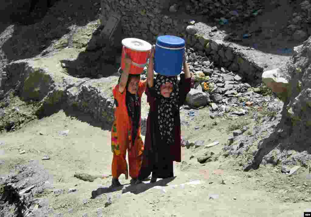 Afghan children carry water to their homes in Kabul (epa) - Much foreign aid has been promised – $4.5 billion in January 2002 and another $4.5 billion in March 2004 – but not all of it has been delivered. The scale of the need is evident in figures that, for example, say that fewer than one in four Afghans has access to safe drinking water. And, in a country prone to drought, and earthquake, additional emergency aid may always be needed.