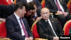 Russian President Vladimir Putin (right) and his Chinese counterpart Xi Jinping attend a gala concert in Shanghai on May 20.