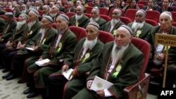 Wearing their traditional costumes (and beards) Turkmen elders listen to Turkmen President Gurbanguly Berdymukhammedov during a meeting in Dashoguz. (file photo)