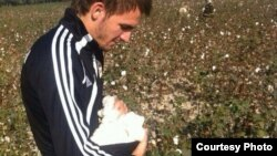 "Uzbekistan - Pavel Smolyachenko, forward at football club ""Neftchi"", picking cotton in a field in Ferghana, October 7, 2013."