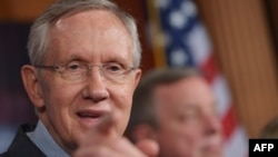 U.S. Senate Majority Leader Harry Reid (in file photo) said the agreement would fund the U.S. government through January 15 and avert a debt default through February 7.