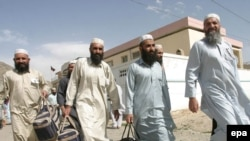 Afghan prisoners leave the U.S. detention center at Bagram Airfield in 2006.